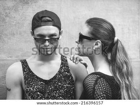 Fashion couple in sunglasses. Vogue - stock photo