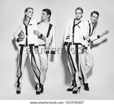 Fashion couple in white suite - stock photo