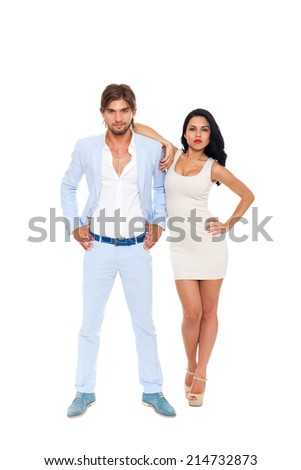 Fashion couple, men wear blue suit and woman sexy dress high heel shoes, full length over white background - stock photo
