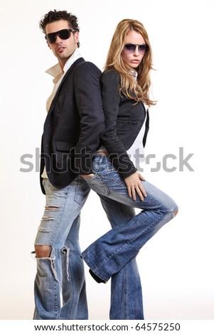 fashion couple posing in studio - stock photo