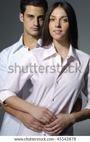 Fashion couple standing and holding, - stock photo