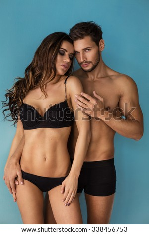 Fashion couple touching each other. Emotional portrait of unusual couple - stock photo