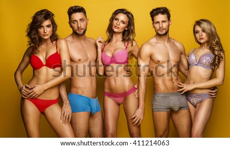 Fashion couples in underwear touching at each other. Emotional portrait of unusual couples - stock photo