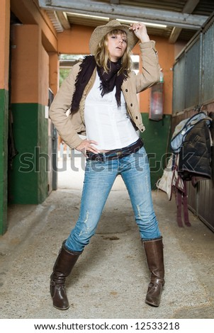 fashion cow girl in a horse stable - stock photo