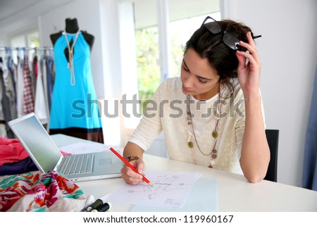 Fashion designer working on creation - stock photo