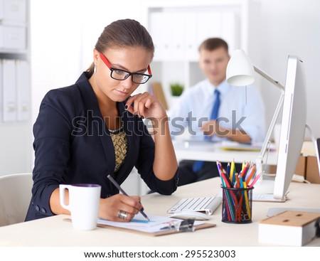 Fashion designers working in studio - stock photo