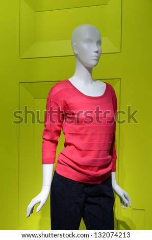 Fashion dummy with red sweater and black pants - stock photo