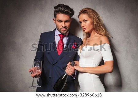 fashion elegant couple ready to drink champagne together to celebrate a birthday - stock photo