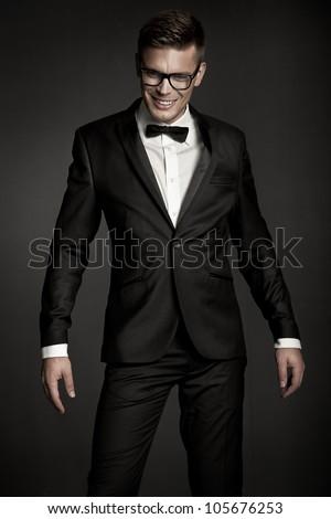 Fashion elegant young black suit man - stock photo