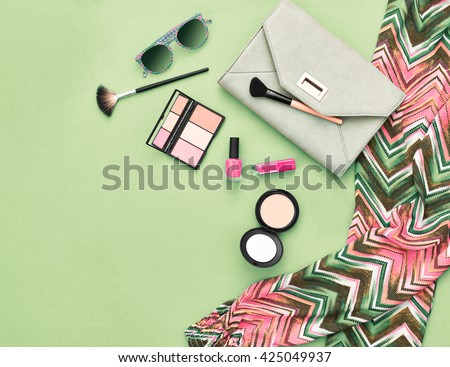 Fashion. Fashion woman essentials.Unusual fashion overhead, top view. Fashion clothes, cosmetics,makeup accessories fashion set.Urban fashion summer colorful outfit.Stylish handbag clutch, sunglasses. - stock photo