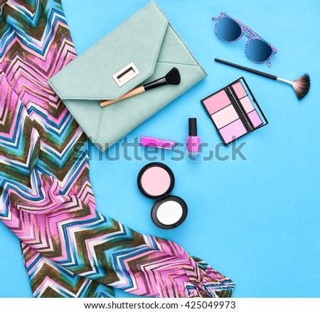 Fashion. Fashion woman essentials.Unusual fashion overhead, top view. Fashion clothes, cosmetics,makeup accessories fashion set.Urban fashion summer colorful outfit.Stylish handbag clutch, sunglasses. - stock photo