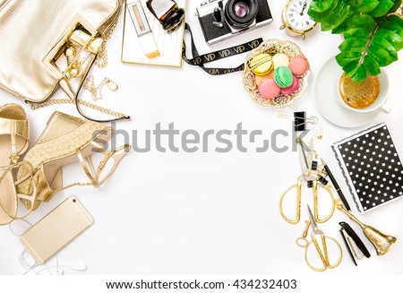 Fashion flat lay for bloggers social media. Feminine accessories, bag, shoes, office supplies, vintage no name photo camera and green plant on white background - stock photo