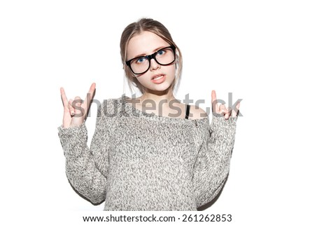 Fashion girl hipster in glasses. Giving the Rock and Roll sign . White background, not isolated - stock photo