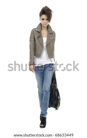 Fashion girl in jeans show in studio - stock photo