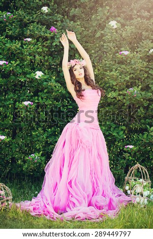 Fashion Girl in Pink Dress Outdoors. Beauty Photo - stock photo