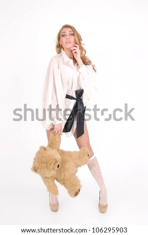 Fashion girl keeps the bear for paw and flirt - stock photo