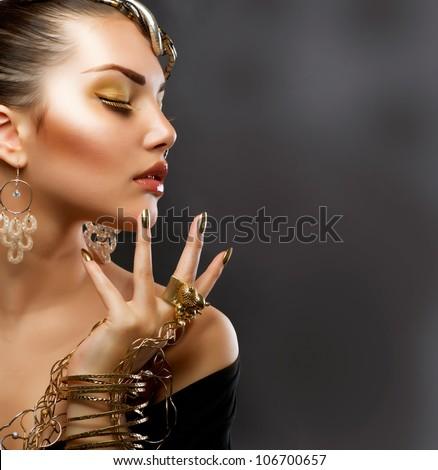 Fashion Girl Portrait. Golden Makeup. - stock photo