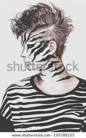 fashion girl wearing a creative zebra makeup - stock photo