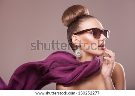 fashion girl with a purple scarf, wearing sunglasses, updo - stock photo