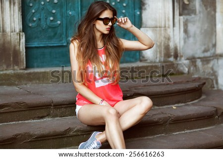 fashion glamor girl in sunglasses sitting in the old town, vintage - stock photo