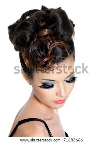 Fashion gorgeous hairstyle for woman with false eyelashes - isolated - stock photo