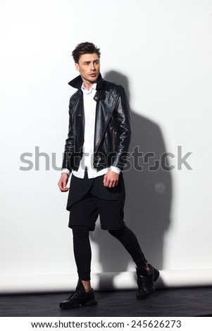 fashion guy in the studio, attractive man - stock photo