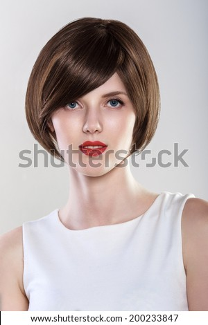 Fashion Hairstyle Glamour Young Woman Portrait. Blue eyes, Red Lips.  - stock photo