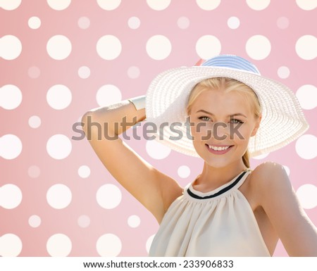 fashion, happiness and people concept - beautiful smiling woman in white summer hat over pink and white polka dots pattern background - stock photo