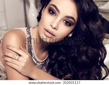 fashion interior photo of beautiful sensual woman with long dark hair wears elegant dress,posing at bedroom - stock photo