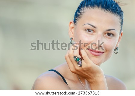 Fashion Lifestyle, Beautiful brunette girl sitting on the beach at the day time. Travel and Vacation. - stock photo
