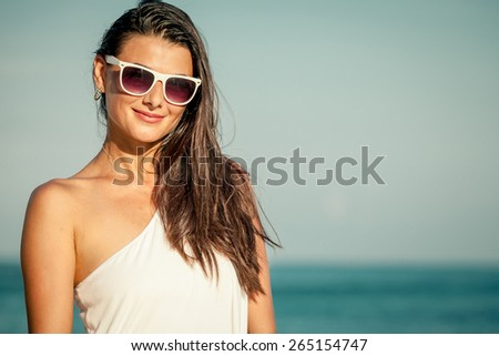 Fashion Lifestyle, Beautiful girl in the sunglasses  on the beach at the day time. Travel and Vacation. - stock photo