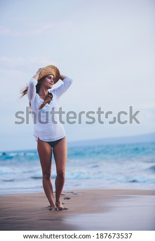 Fashion Lifestyle, Beautiful girl on the beach at sunset. - stock photo