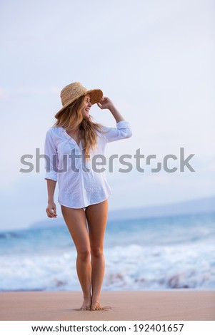 Fashion Lifestyle, Beautiful girl on the beach at sunset. Looking out to sea - stock photo