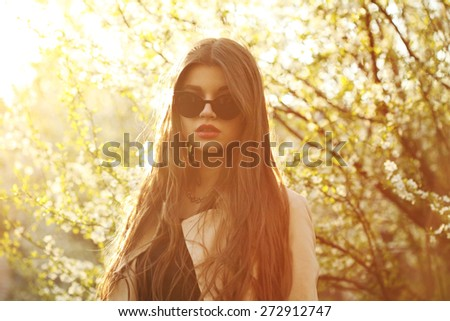 Fashion lifestyle portrait pretty woman in the sunglasses posing in the city summer, evening sunset sunny light, street fashion - stock photo