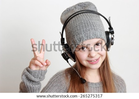 Fashion little girl with headphone singing - stock photo