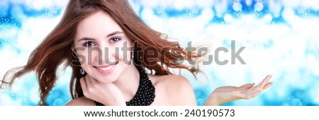 Fashion Magic Woman over blue Winter background. - stock photo