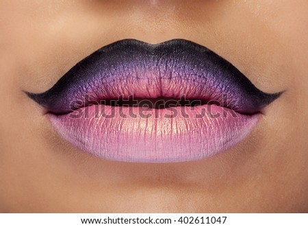 Fashion make up on mouth in artistic interpretation. Close up photo - stock photo