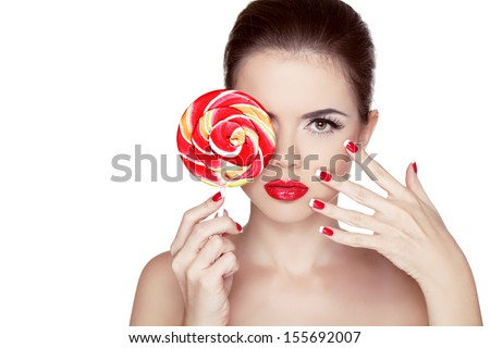 Fashion makeup. Beauty Girl Portrait holding Colorful lollipop. Hot red lips. Nail polish manicured nails. Skin care. Isolated on white background - stock photo