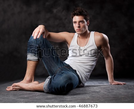 Fashion male portrait looking away deep in thought - isolated over a black background - stock photo