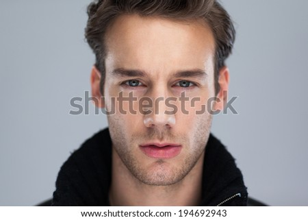 Fashion man face close up, Handsome serious beauty male model closeup portrait, young guy over gray background - stock photo