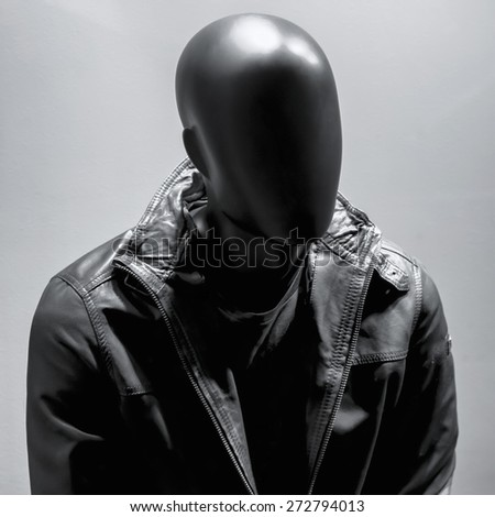 Fashion mannequin in black leather coat over dark grey background. Black White - stock photo