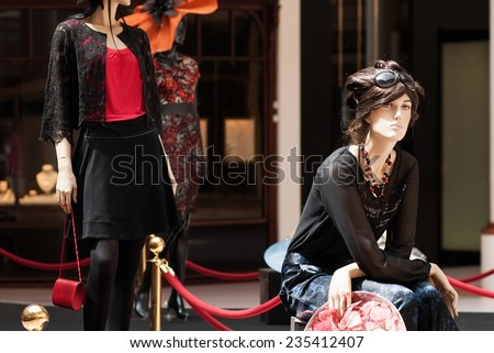 Fashion mannequins at the mall. luxury clothing store. Grain added - stock photo