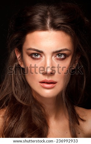 Fashion middle-age woman with perfect skin and make-up, studio shot, black background. Beauty close-up portrait - stock photo
