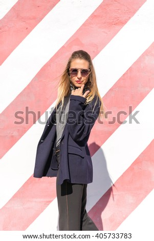 Fashion Model girl posing. Beauty stylish blonde woman with pink lips and perfect make-up posing in studio. High fashion, urban style. - stock photo