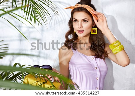 Fashion model glamour style accessory portrait sexy woman perfect body shape jewelry brunette hairdo natural makeup palm leaves tropical vocation clothes wear summer mood collection catalog - stock photo