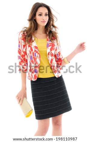 fashion model holding little purse shot on white background in studio - stock photo