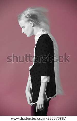 fashion model in designer dress poses on pink background - stock photo