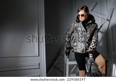 fashion model in fashion dress in sunglasses posing in the studio - stock photo