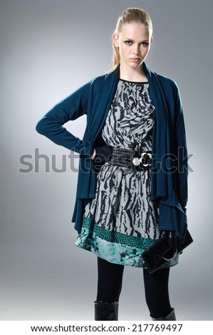 fashion model in fashion dress posing on gray background - stock photo