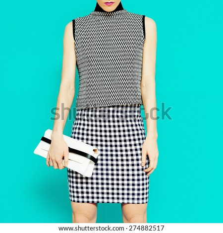 Fashion model in stylish clothes. Geometric combination trend - stock photo